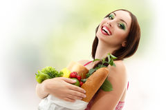 Woman happy holding food bag Stock Photos