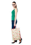 Woman happy holding shopping bags Stock Image