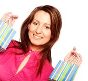 Woman happy holding shopping bags. Stock Photo
