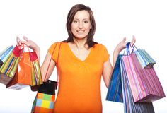 Woman happy holding shopping bags. Royalty Free Stock Image