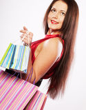 Woman happy holding shopping bags. Royalty Free Stock Images
