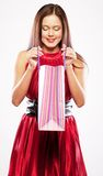 Woman happy holding shopping bags. Stock Images