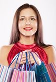 Woman happy holding shopping bags. Royalty Free Stock Photo