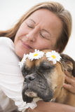 Woman happy in  love with boxer pet dog. Portrait attractive Woman in blurred background with boxer dog pet friend cuddling, showing love and affection Royalty Free Stock Photo