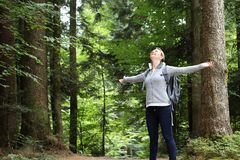 Woman happy in nature forest with outspread arms. A Woman happy in nature forest spreading out their armes stock photos