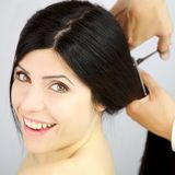 Woman happy about new haircut from long to short Stock Photo