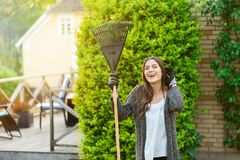 Woman happy outdoor in the backyard, gardening stock photography