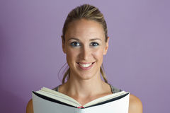 Woman happy reading book Stock Photos