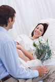 Woman is happy about receiving a visit at the hospital Stock Photo