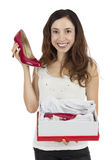 Woman happy with red shoes as a gift Royalty Free Stock Photo