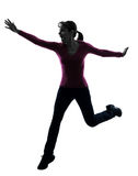 Woman happy running jumping silhouette Royalty Free Stock Photos