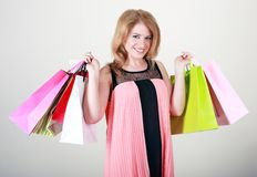 Woman happy. Shopping adult woman happy smiling holding shopping bags Royalty Free Stock Photos