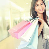 Woman happy with shopping bags Royalty Free Stock Photography