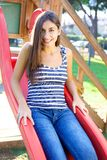 Woman happy on slide in park Stock Images