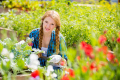 Woman with happy smile in garden Royalty Free Stock Image