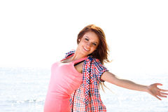 Woman happy smiling joyful. Happiness bliss freedom concept. Woman happy smiling joyful with arms up dancing on beach in summer during holidays travel. Beautiful Royalty Free Stock Image