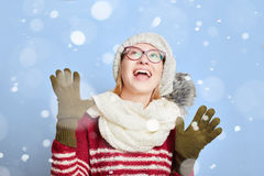 Woman happy about the snow in winter Stock Photography