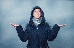 Woman is happy about snowfall Stock Photos