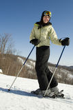 Woman happy to be outside skiing Royalty Free Stock Image