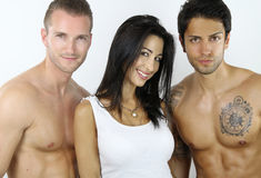 Woman happy to be with two sexy men Royalty Free Stock Images