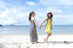 Woman happy together on sand beach Royalty Free Stock Image
