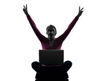 Woman happy winning  computing laptop computer silhouette Royalty Free Stock Image
