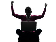 Woman happy winning computing laptop computer silhouette Royalty Free Stock Images