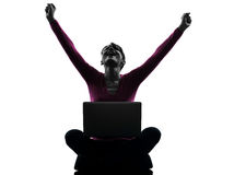 Woman happy winning computing laptop computer silhouette Stock Photography