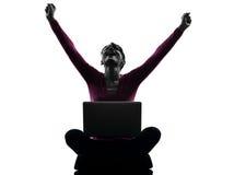 Woman happy winning computing laptop computer silhouette Stock Photography