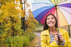Free Woman Happy With Umbrella Under The Rain During Autumn Forest Walk. Girl Enjoying Rainy Fall Day Looking Up At Sky Stock Image - 194999941