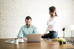 Woman harassing new employee Royalty Free Stock Image