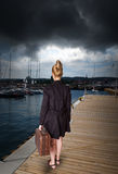 Woman at harbor - before storm Stock Photo