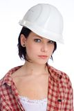 Woman with hard-hat. Young serious looking craftswoman wearing a hard-hat Stock Photos