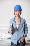Woman in hard hat Royalty Free Stock Photography
