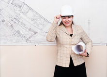 Woman in hard hat with blueprints Royalty Free Stock Photos