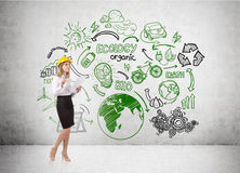 Woman in hard hat and eco sketch Stock Photos