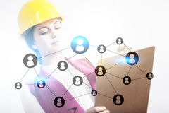 Woman in hard hat and network sketch Stock Photo