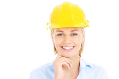 Woman in a hard hat. A picture of a pretty woman in a yellow hard hat over white background Stock Photo