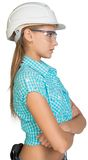 Woman in hard hat and protective glasses Stock Photos