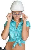 Woman in hard hat and protective glasses Royalty Free Stock Photo