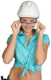 Woman in hard hat and protective glasses Royalty Free Stock Images