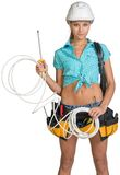 Woman in hard hat and tool belt holding coil of Royalty Free Stock Photography