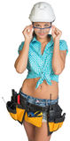 Woman in hard hat, tool belt and protective Stock Photography