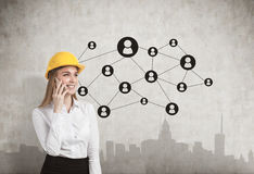 Woman in hardhat, concrete wall, network, city Stock Images
