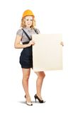 Woman in hardhat holding banner Royalty Free Stock Photos