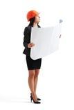 Woman in hardhat holding blueprint Stock Photos