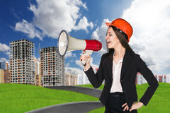 Woman in hardhat with megaphone Royalty Free Stock Photography