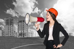Woman in hardhat with megaphone Royalty Free Stock Images