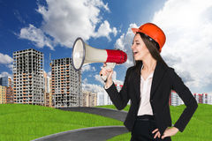 Woman in hardhat with megaphone Royalty Free Stock Image