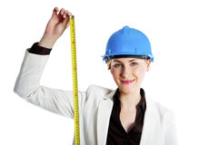 Woman in hardhat with meter Royalty Free Stock Photography
